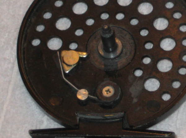 Trout reel - click and pawl